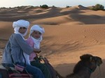 girls-in-desert-on-camels